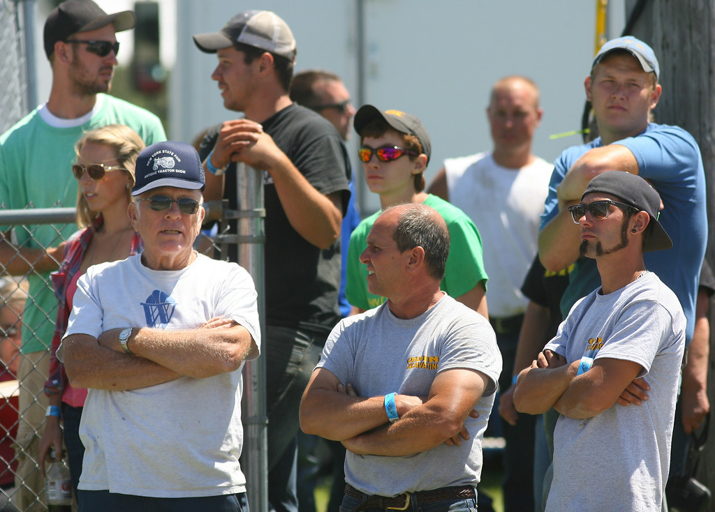 Description of . Tractor pull fans look on during the tractor pull competition at the Boonville Oneida County Fair on Thursday, July 24, 2014 in Boonville. The fair runs through Sunday, July 27, 2014. JOHN HAEGER-ONEIDA DAILY DISPATCH @ONEIDAPHOTO ON TWITTER