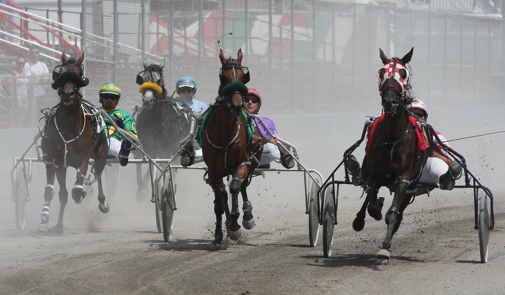 Description of . Horses and drivers leave the start gate for harness racing at the Boonville Oneida County Fair on Tuesday, July 22, 2014 in Boonville. the fair runs through Sunday, July 27, 2014.  JOHN HAEGER-ONEIDA DAILY DISPATCH @ONEIDAPHOTO ON TWITTER