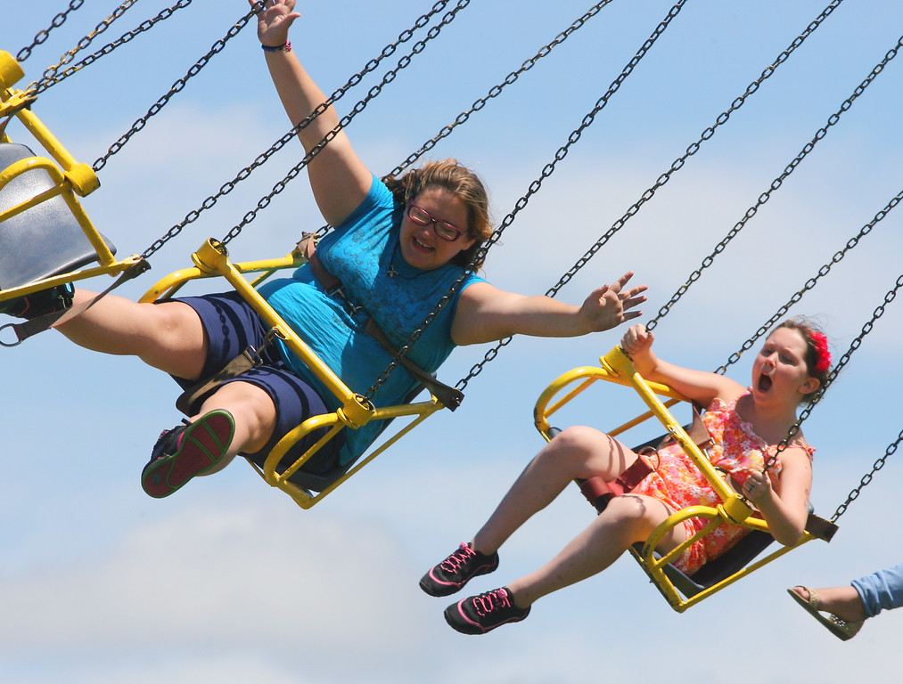 Description of . fair goers ride on the Yo Yo on the midway at the Boonville Oneida County Fair on Thursday, July 24, 2014 in Boonville. The fair runs through Sunday, July 27, 2014. JOHN HAEGER-ONEIDA DAILY DISPATCH @ONEIDAPHOTO ON TWITTER