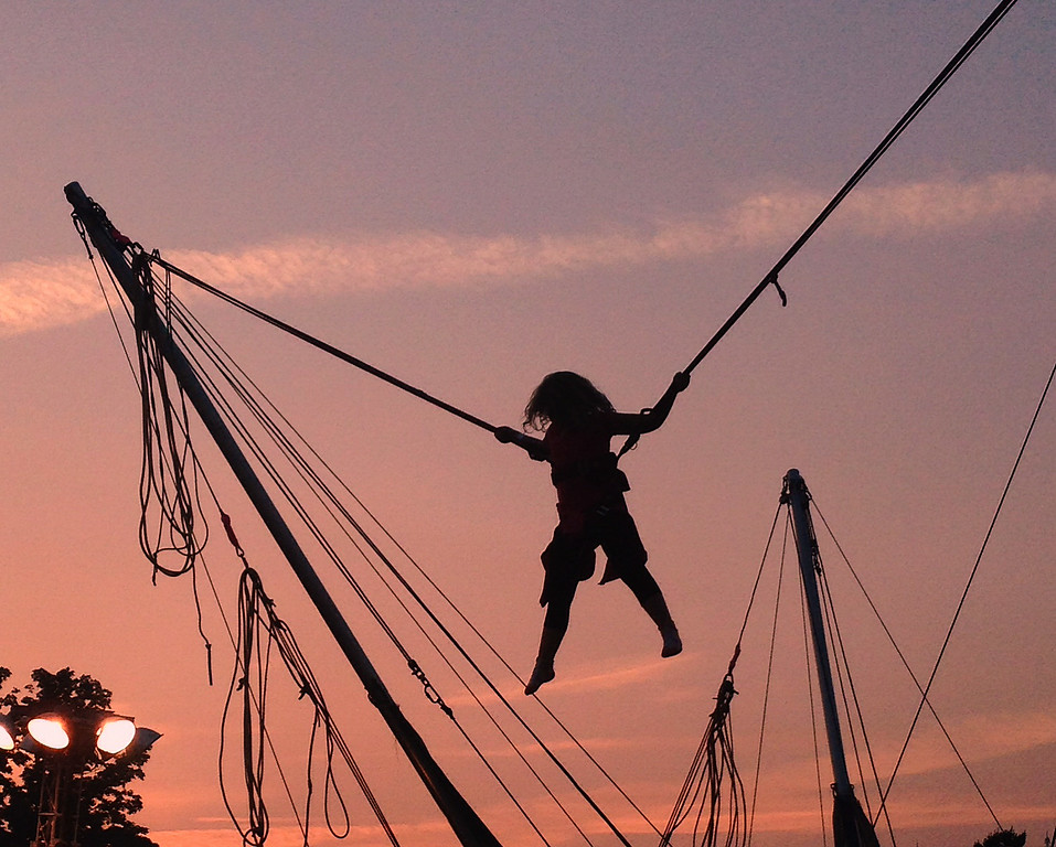 Description of . A fairgoers is silhouetted against the evening sky as they ride one of the midway rides at the Boonville Oneida County Fair on Friday July 25, 2014. JOHN HAEGER-ONEIDA DAILY DISPATCH @ONEIDAPHOTO ON TWITTER