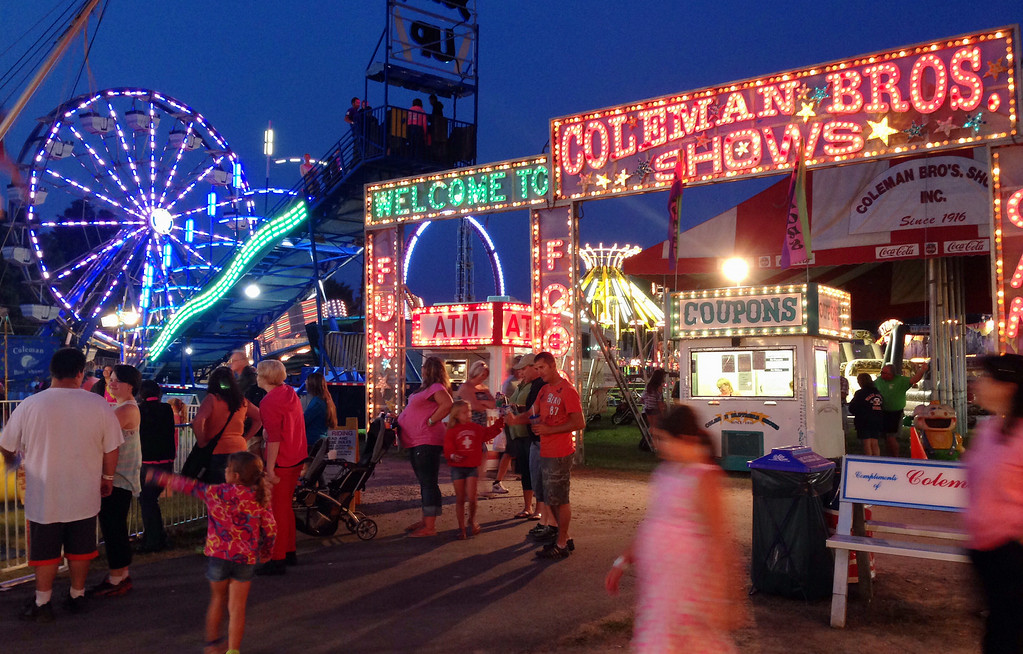 Description of . A section of the midway  at the Boonville Oneida County Fair on Friday July 25, 2014. JOHN HAEGER-ONEIDA DAILY DISPATCH @ONEIDAPHOTO ON TWITTER