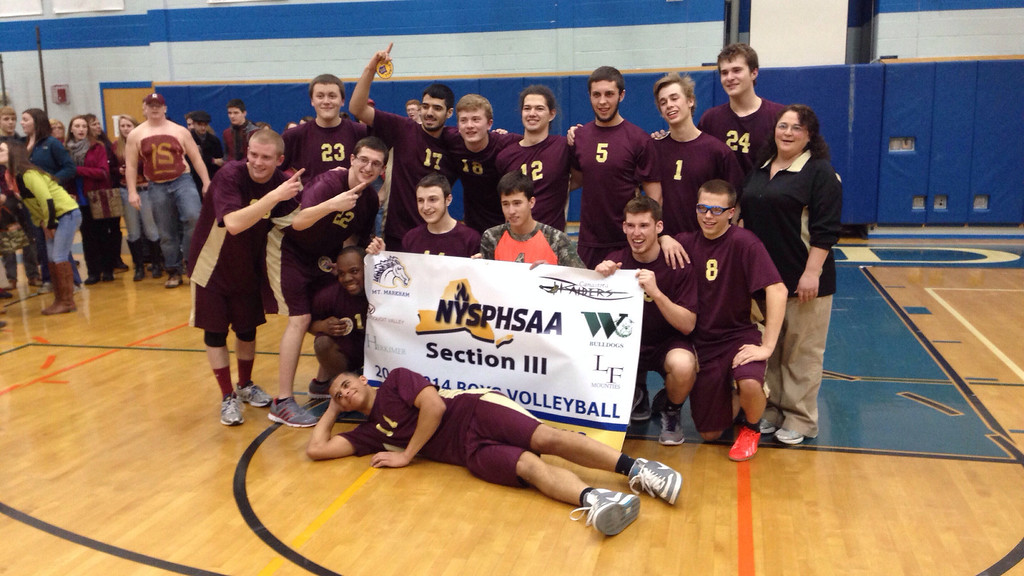 Description of . Canastota players pose with their banner after winning the Section Class C final against Mount Markham in Oneida on Thursday, March 6, 2014. JOHN HAEGER - ONEIDA DAILY DISPATCH @ONEIDAPHOTO ON TWITTER
