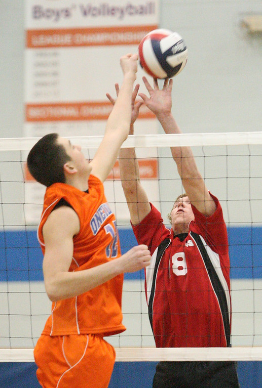 Description of . Oneida's Alex Nemeti (12) and VVS' Tim Beal (18) battle above the net for the point during the Section III Class B final in Oneida on Thursday, March 6, 2014. JOHN HAEGER - ONEIDA DAILY DISPATCH @ONEIDAPHOTO ON TWITTER