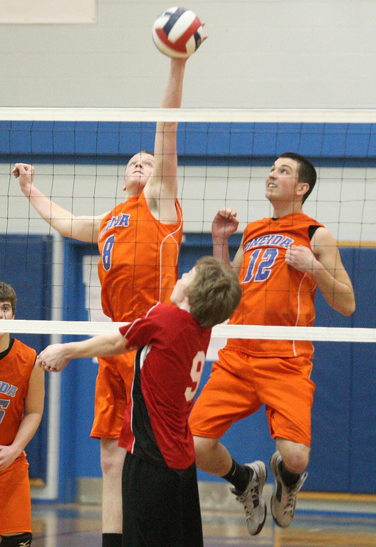 Description of . Oneida's  Steve Patricia (8) slams the ball over the net as VVS' Donald Coffin (9) reacts and Oneida's Alex Nemeti (12) backs up the play during the Section III Class B final in Oneida on Thursday, March 6, 2014. JOHN HAEGER - ONEIDA DAILY DISPATCH @ONEIDAPHOTO ON TWITTER