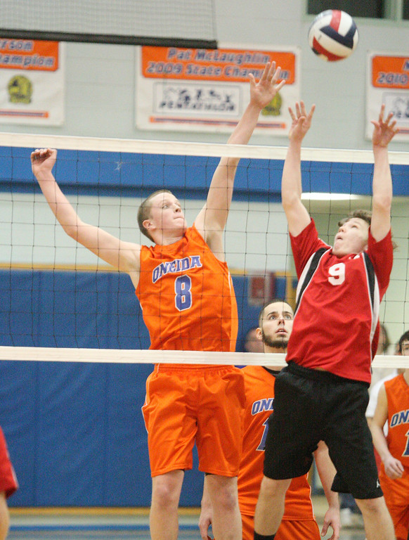 Description of . Oneida's  Steve Patricia (8) and VVS' Donald Coffin (9) play the ball during the Section III Class B final in Oneida on Thursday, March 6, 2014. JOHN HAEGER - ONEIDA DAILY DISPATCH @ONEIDAPHOTO ON TWITTER
