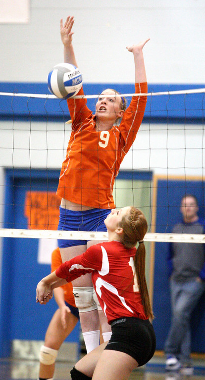 Description of . VVS' Brandi Edwards (13) puts a shot over the net as Oneida's Paige Pickard (9) defends in the first game of the match at Oneida on Thursday, Dec. 4, 2013. Oneida won 3-1.JOHN HAEGER-ONEIDA DAILY DISPATCH @ONEIDAPHOTO ON TWITTER