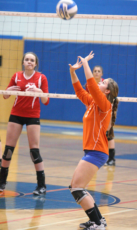 Description of . Oneida's Erica Kristan (5) sets the ball as VVS' Emily Brown (22)  looks on in the first game of the match at Oneida on Thursday, Dec. 4, 2013. Oneida won 3-1.JOHN HAEGER-ONEIDA DAILY DISPATCH @ONEIDAPHOTO ON TWITTER