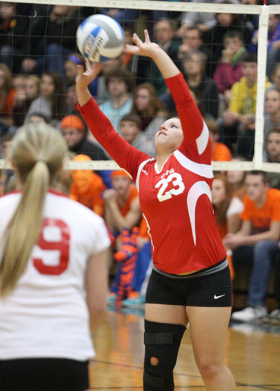 Description of . VVS' Selena Hass (23) puts a shot over the net  in the first game of the match against Oneida at Oneida on Wednesday, Dec. 4, 2013. VVS won the first game 25-18. JOHN HAEGER-ONEIDA DAILY DISPATCH @ONEIDAPHOTO ON TWITTER