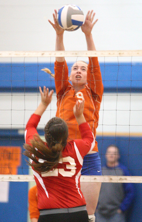 Description of . VVS' Selena Hass (23) reacts as Oneida's Paige Pickard (9) blocks a shot in the first game of the match at Oneida on Wednesday, Dec. 4, 2013. VVS won the first game 25-18. JOHN HAEGER-ONEIDA DAILY DISPATCH @ONEIDAPHOTO ON TWITTER