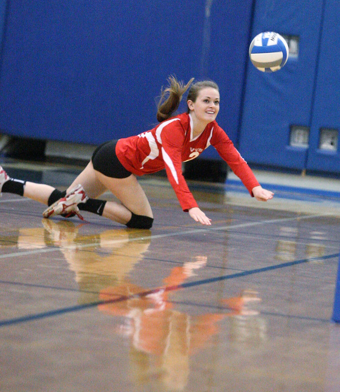Description of . VVS' Annabelle Willey (2) dives to make the save  in the first game of the match against Oneida  at Oneida on Thursday, Dec. 4, 2013. Oneida won 3-1.JOHN HAEGER-ONEIDA DAILY DISPATCH @ONEIDAPHOTO ON TWITTER