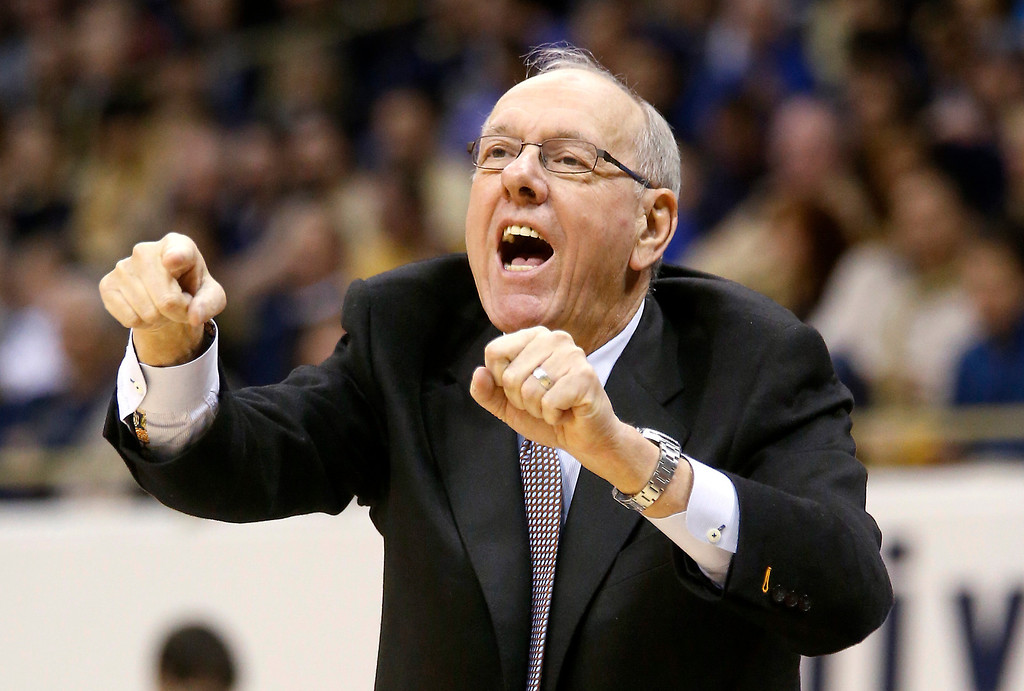 Description of . Syracuse coach Jim Boeheim yells to his team during the first half of an NCAA college basketball game against Pittsburgh on Wednesday, Feb. 12, 2014, in Pittsburgh. Syracuse won 58-56. (AP Photo/Keith Srakocic)
