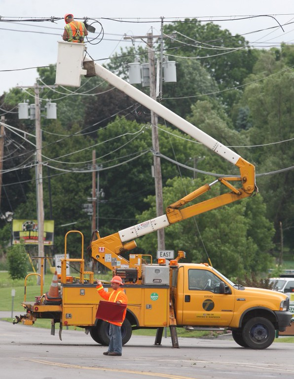 Description of . NYS DOT crews work to repair the traffic signals at the intersection of Route 31 and Route 365 in Verona following  storm on Wednesday, June 18, 2014. JOHN HAEGER @ONEIDAPHOTO ON TWITTER/ONEIDA DAILY DISPATCH