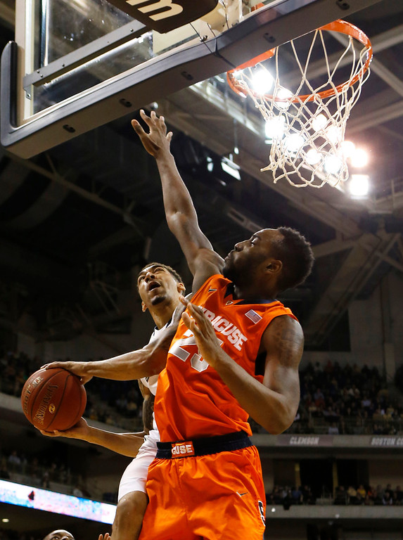Description of . Pittsburgh's Cameron Wright, left, shoots around Syracuse's Rakeem Christmas (25)during the first half of an NCAA college basketball game on Wednesday, Feb. 12, 2014, in Pittsburgh. (AP Photo/Keith Srakocic)