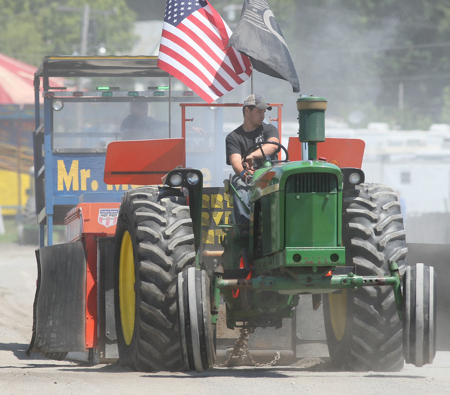 Description of . Kyle Smith competes in the tractor pull competition at the Boonville Oneida County Fair on Thursday, July 24, 2014 in Boonville. The fair runs through Sunday, July 27, 2014. JOHN HAEGER-ONEIDA DAILY DISPATCH @ONEIDAPHOTO ON TWITTER