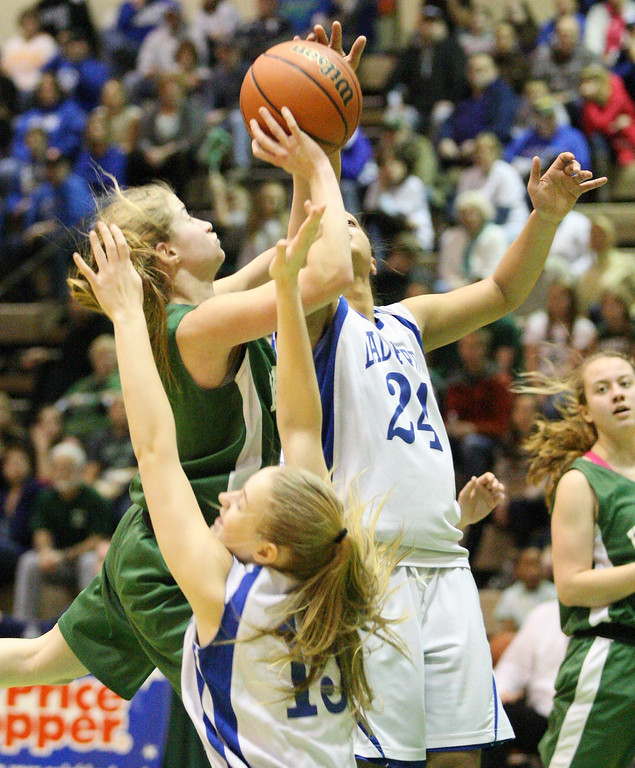 Description of . Hamilton's Jessica Welsh (3) goes up for the shot as Ft Edwards  players defends in the second half of the NYSPHSAA Class D semifinal in Troy on Saturday, March 15, 2014.JOHN HAEGER-ONEIDA DAILY DISPATCH @ONEIDAPHOTO ON TWITTER