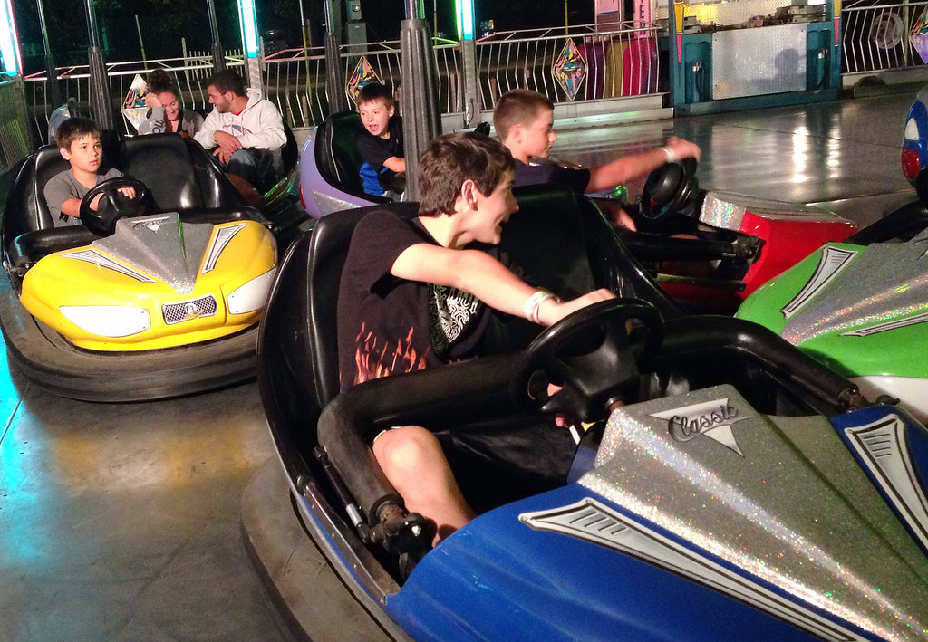 Description of . Riders bump and slam as they ride the bumper cars of the midway  at the Boonville Oneida County Fair on Friday July 25, 2014. JOHN HAEGER-ONEIDA DAILY DISPATCH @ONEIDAPHOTO ON TWITTER