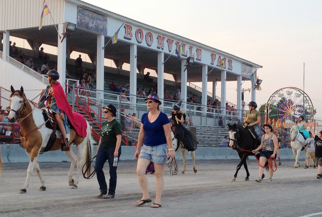 Description of . 4-H members and their horses take part in the annual parade at the Boonville Oneida County Fair on Tuesday, July 22, 2014 in Boonville. the fair runs through Sunday, July 27, 2014.  JOHN HAEGER-ONEIDA DAILY DISPATCH @ONEIDAPHOTO ON TWITTER