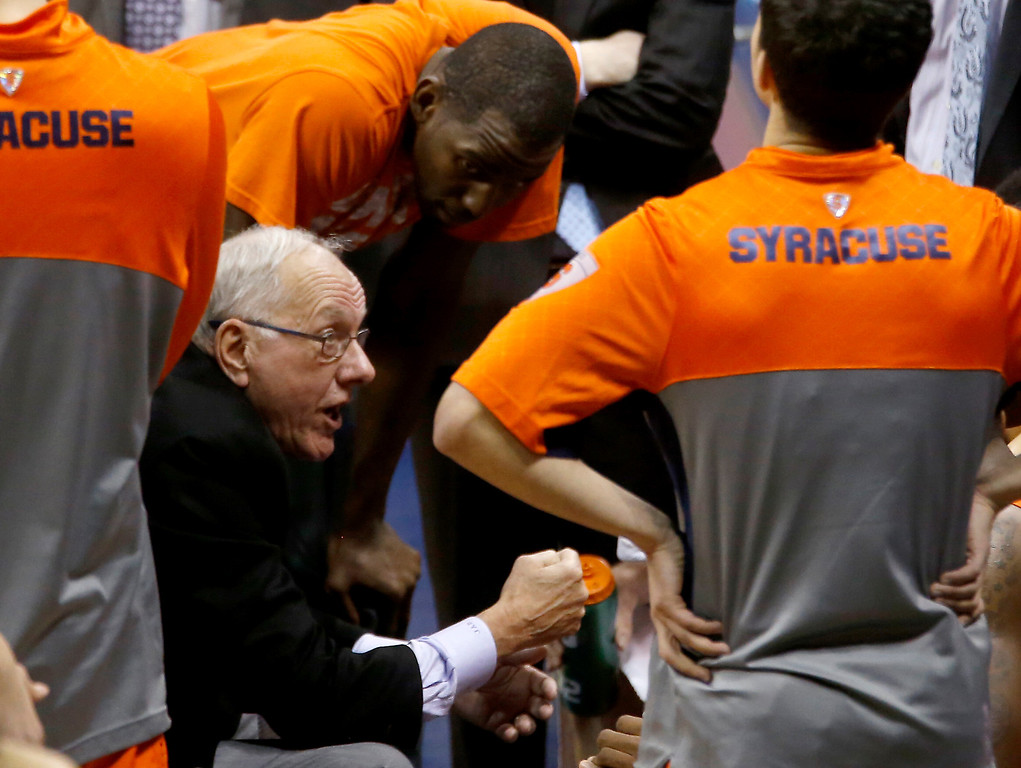 Description of . Syracuse head coach jim Boeheim talks with his team during a timeout against Pittsburgh in the second half of an NCAA college basketball game on Wednesday, Feb. 12, 2014, in Pittsburgh. Syracuse won 58-56 on a three point shot with less than a second left in the game. (AP Photo/Keith Srakocic)