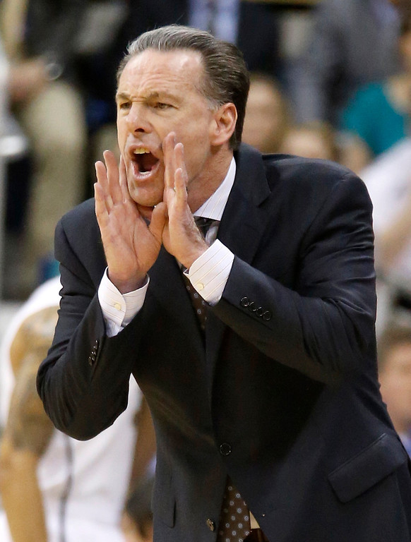 Description of . Pittsburgh coach Jamie Dixon yells to his team during the first half of an NCAA college basketball game against Syracuse on Wednesday, Feb. 12, 2014, in Pittsburgh. Syracuse won 58-56. (AP Photo/Keith Srakocic)