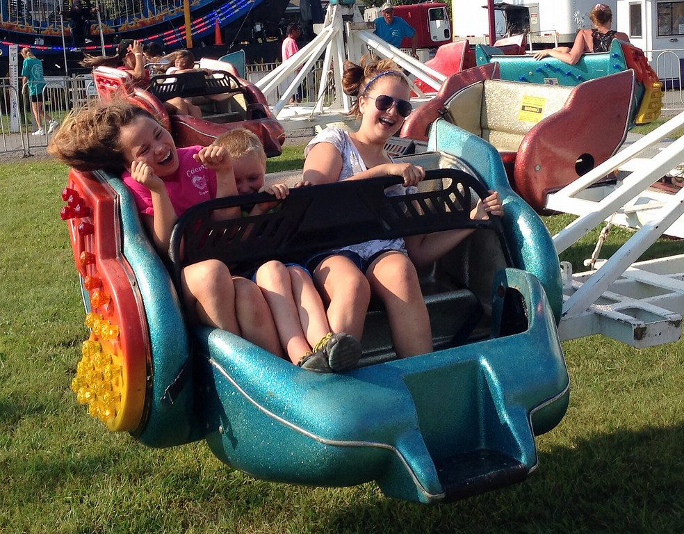 Description of . Fair goers reacts as they ride  on the rides on the midway at the Boonville Oneida County Fair on Tuesday, July 22, 2014 in Boonville. the fair runs through Sunday, July 27, 2014. JOHN HAEGER-ONEIDA DAILY DISPATCH @ONEIDAPHOTO ON TWITTER