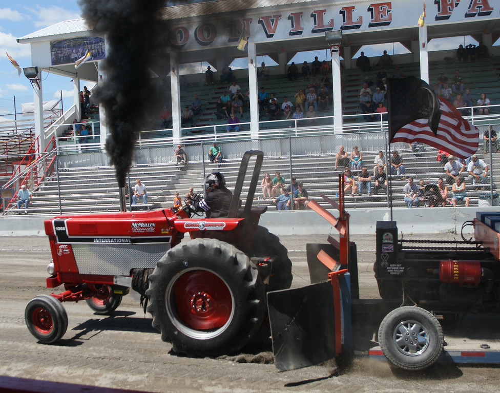 Description of . Dustin McMullen  competes in the tractor pull competition at the Boonville Oneida County Fair on Thursday, July 24, 2014 in Boonville. McMullen pulled 277 feet on his attempt The fair runs through Sunday, July 27, 2014. JOHN HAEGER-ONEIDA DAILY DISPATCH @ONEIDAPHOTO ON TWITTER