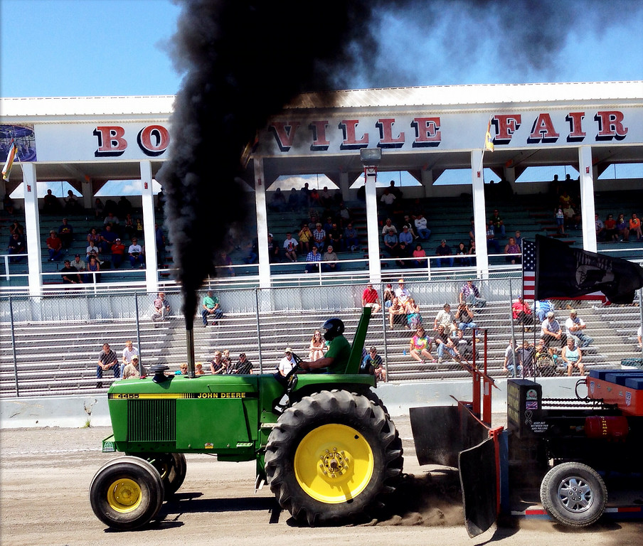 Description of . Jim Lewis competes in the tractor pull competition at the Boonville Oneida County Fair on Thursday, July 24, 2014 in Boonville. The fair runs through Sunday, July 27, 2014. JOHN HAEGER-ONEIDA DAILY DISPATCH @ONEIDAPHOTO ON TWITTER