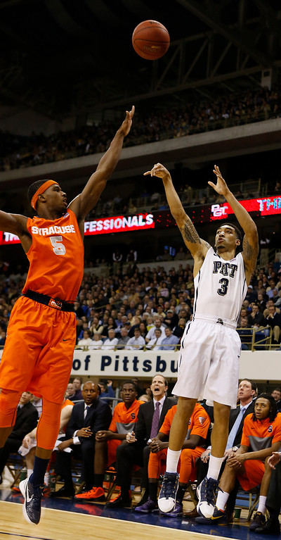 Description of . Pittsburgh's Cameron Wright (3) shoots over Syracuse's C.J. Fair during the first half of an NCAA college basketball game on Wednesday, Feb. 12, 2014, in Pittsburgh. (AP Photo/Keith Srakocic)