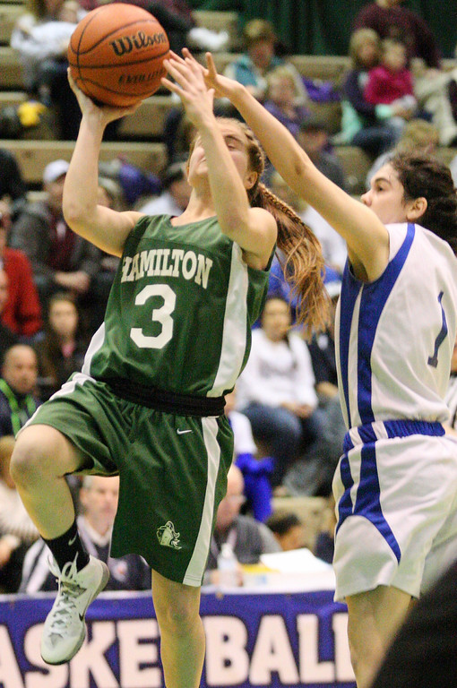 Description of . Hamilton's Jessica Welsh (3) goes up for the shot as Ft Edwards  Brittni Sardina (1)  defends in the second half of the NYSPHSAA Class D semifinal in Troy on Saturday, March 15, 2014.JOHN HAEGER-ONEIDA DAILY DISPATCH @ONEIDAPHOTO ON TWITTER
