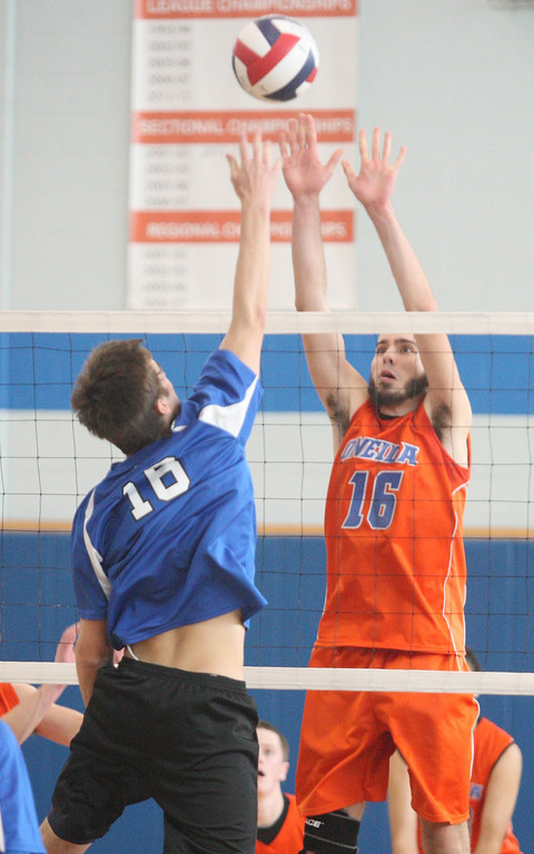 . Oneida\'s Zach Brown (16) and Ichabod Crane\'s Will Baumbach (10) battle above the net in the NYSPHSAA Class B Regionals in Oneida on Saturday, March 8, 2014. JOHN HAEGER-ONEIDA DAILY DISPATCH @ONEIDAPHOTO ON TWITTER