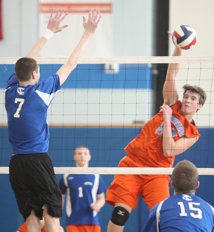. Oneida\'s David Kann (25) puts the ball over the net as Ichabod Crane\'s Shane Wenz (7) defends in the NYSPHSAA Class B Regionals in Oneida on Saturday, March 8, 2014. JOHN HAEGER-ONEIDA DAILY DISPATCH @ONEIDAPHOTO ON TWITTER