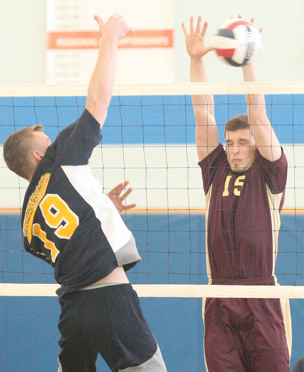 . Mt Markham\'s Zach Brown (19) has his shot blocked by Canastota\'s Connor Hanauer (15) in the Sec 3 Class C finals in Oneida on Thursday, March 6, 2014. JOHN HAEGER-ONEIDA DAILY DISPATCH @ONEIDAPHOTO ON TWITTER