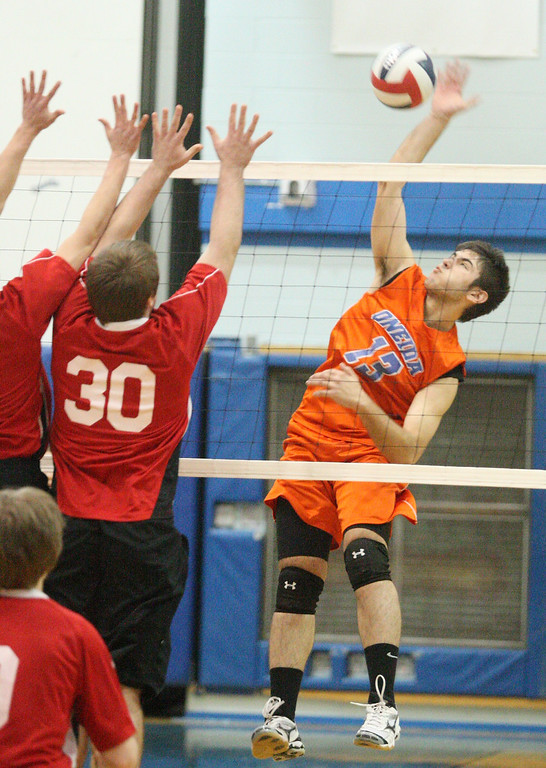 . Oneida\'s Derek Connelly (13) puts a shot over as VVS\' Ryan Oliver (30) defends during the Section III Class B final in Oneida on Thursday, March 6, 2014. JOHN HAEGER - ONEIDA DAILY DISPATCH @ONEIDAPHOTO ON TWITTER