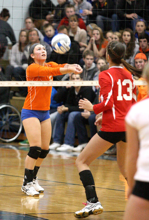 . Oneida\'s Erica Kristan (5) sets the ball as VVS\' Brandi Edwards (13) looks on in the first game of the match at Oneida on Thursday, Dec. 4, 2013. Oneida won 3-1.JOHN HAEGER-ONEIDA DAILY DISPATCH @ONEIDAPHOTO ON TWITTER