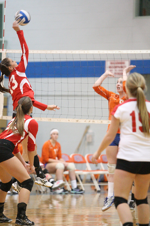. VVS\' Brandi Edwards (13) puts a shot over the net as Oneida\'s Paige Pickard (9) defends in the first game of the match at Oneida on Thursday, Dec. 4, 2013. Oneida won 3-1.JOHN HAEGER-ONEIDA DAILY DISPATCH @ONEIDAPHOTO ON TWITTER