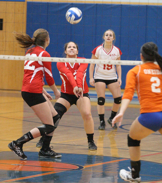 . VVS\' Samantha Kogut (25) set the ball as teammate  VVS\' Emily Brown (22) backs up the play and Oneida\'s Summer Lancette (2) looks on in the first game of the match at Oneida on Thursday, Dec. 4, 2013. Oneida won 3-1.JOHN HAEGER-ONEIDA DAILY DISPATCH @ONEIDAPHOTO ON TWITTER
