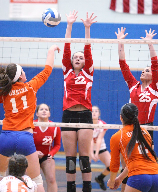 . Oneida\'s Matteson Mair (11) puts a shot over the net as VVS\' Emily Brown (22) and Samantha Kogut (25) defend in the first game of the match at Oneida on Thursday, Dec. 4, 2013. Oneida won 3-1.JOHN HAEGER-ONEIDA DAILY DISPATCH @ONEIDAPHOTO ON TWITTER