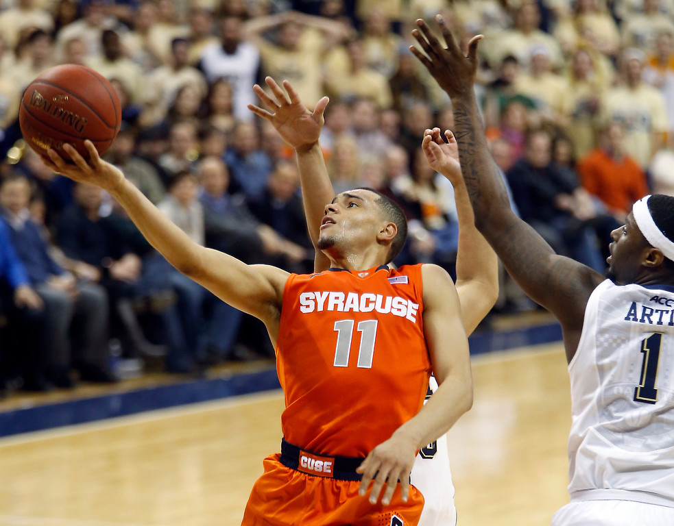 . Syracuse\'s Tyler Ennis (11) shoots after getting past Pittsburgh\'s Jamel Artis (1) during the second half of an NCAA college basketball game Wednesday, Feb. 12, 2014, in Pittsburgh. (AP Photo/Keith Srakocic)