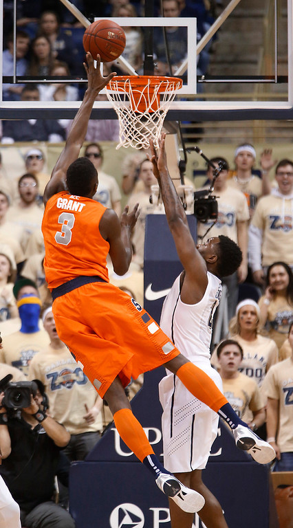 . Syracuse\'s Jerami Grant (3) shoots over Pittsburgh\'s Michael Young during the first half of an NCAA college basketball game Wednesday, Feb. 12, 2014, in Pittsburgh. (AP Photo/Keith Srakocic)