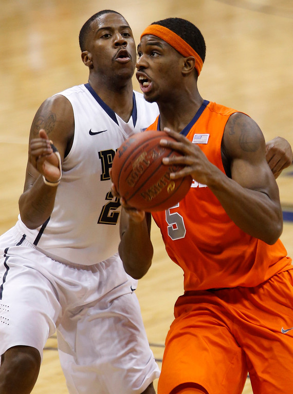 . Syracuse\'s C.J. Fair (5) looks to shoot past Pittsburgh\'s Lamar Patterson during the second half of an NCAA college basketball game on Wednesday, Feb. 12, 2014, in Pittsburgh. (AP Photo/Keith Srakocic)