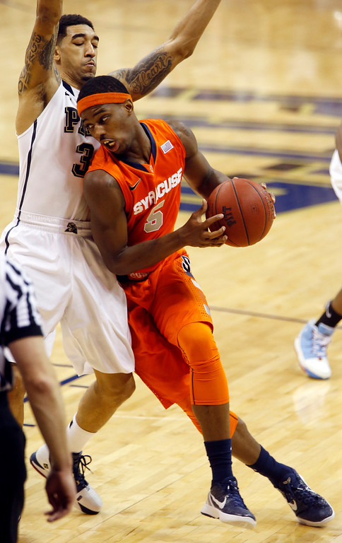 . Syracuse\'s C.J. Fair (5) gets around Pittsburgh\'s Cameron Wright during the second half of an NCAA college basketball game on Wednesday, Feb. 12, 2014, in Pittsburgh. (AP Photo/Keith Srakocic)