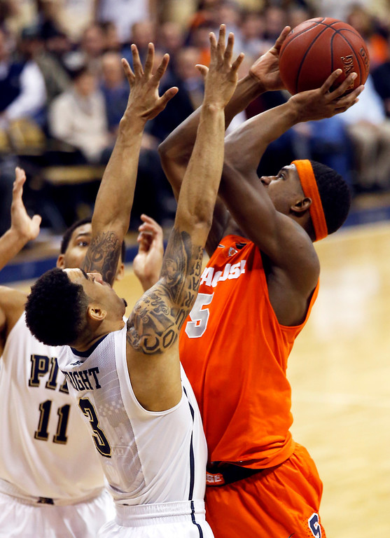 . Syracuse\'s C.J. Fair (5) shoots over Pittsburgh\'s Cameron Wright (3) during the second half of an NCAA college basketball game Wednesday, Feb. 12, 2014, in Pittsburgh. (AP Photo/Keith Srakocic)