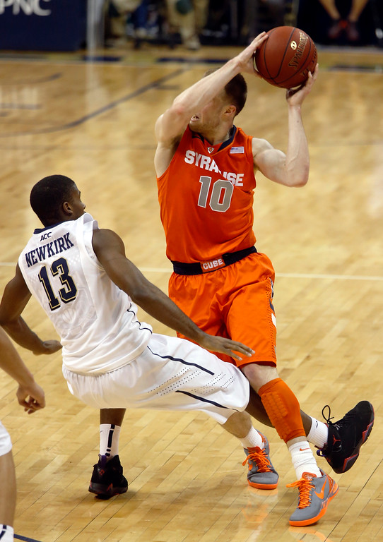 . Syracuse\'s Trevor Cooney (10) is called for a foul as Pittsburgh\'s Josh Newkirk (13) defends during the second half of an NCAA college basketball game on Wednesday, Feb. 12, 2014, in Pittsburgh. (AP Photo/Keith Srakocic)