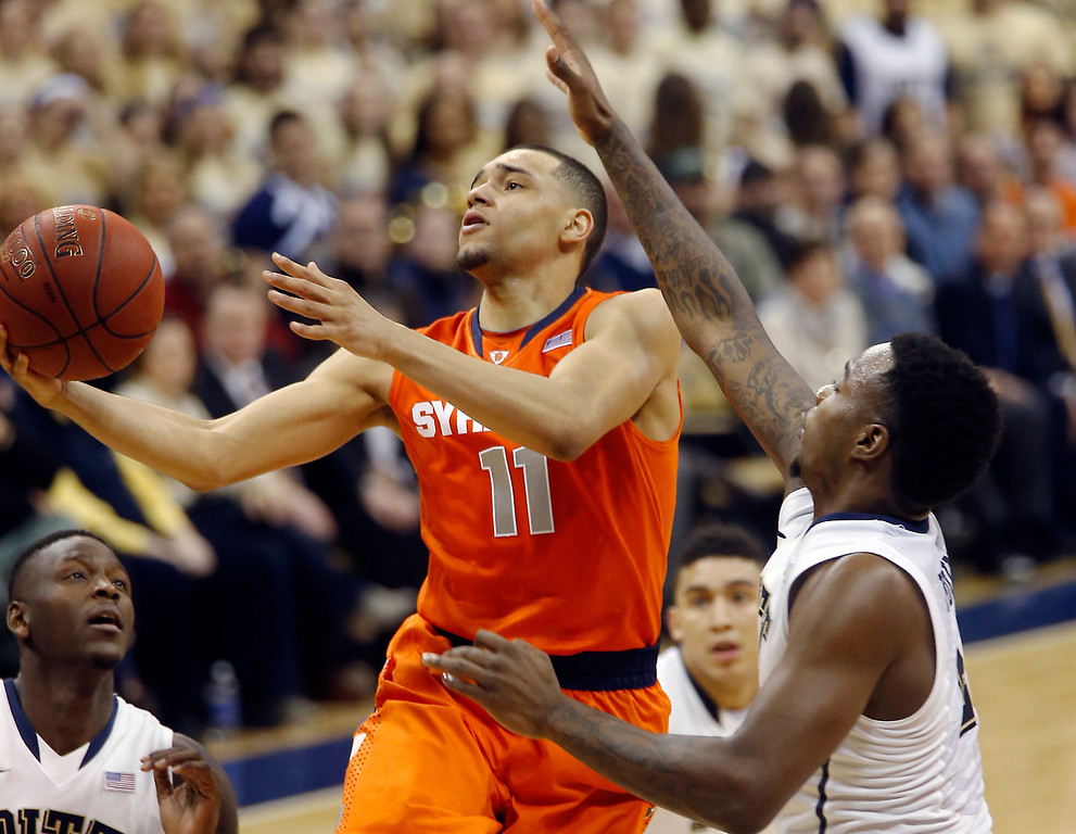 . Syracuse\'s Tyler Ennis (11) shoots after getting past Pittsburgh\'s Pittsburgh\'s Michael Young during the second half of an NCAA college basketball game on Wednesday, Feb. 12, 2014, in Pittsburgh. (AP Photo/Keith Srakocic)