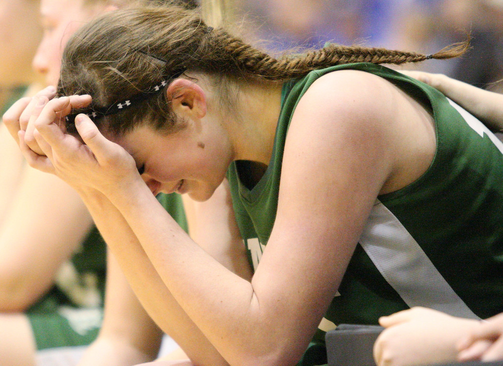 . Hamilton\'s Sarah Foster (13) sits on the bench and reacts to her teams lost Ft Edwards  in the final seconds  of the NYSPHSAA Class D semifinal in Troy on Saturday, March 15, 2014.JOHN HAEGER-ONEIDA DAILY DISPATCH @ONEIDAPHOTO ON TWITTER