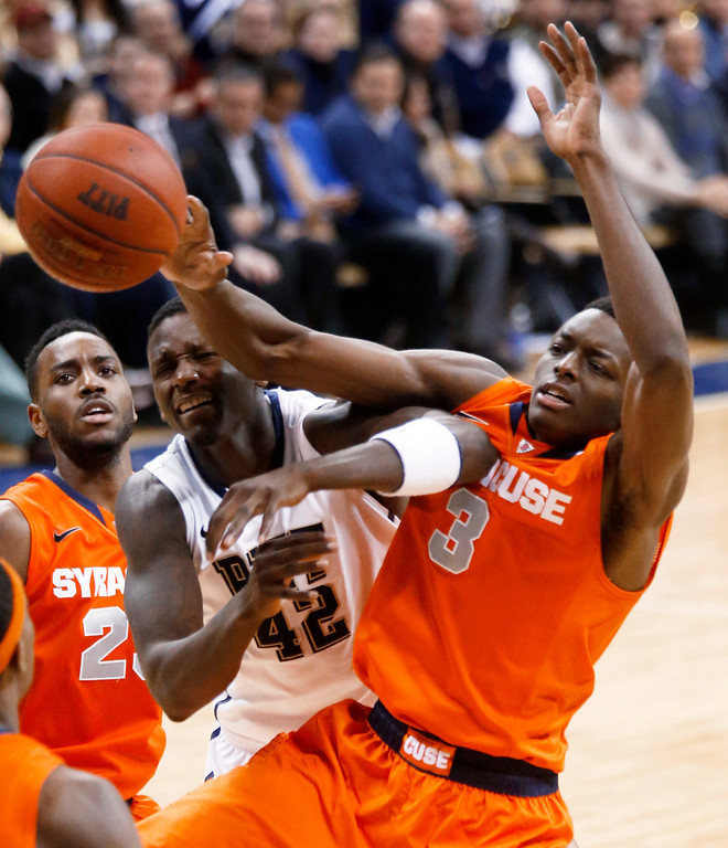 . Pittsburgh\'s Talib Zanna (42) and Syracuse\'s Jerami Grant compete for a rebound during the second half of an NCAA college basketball game Wednesday, Feb. 12, 2014, in Pittsburgh. (AP Photo/Keith Srakocic)